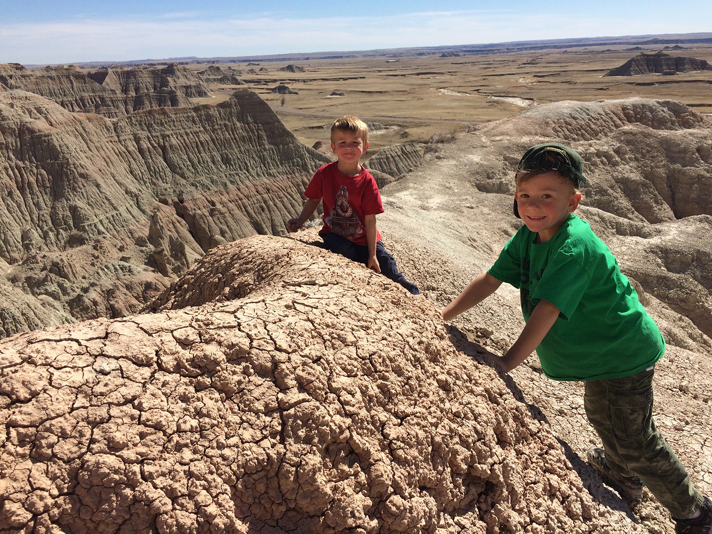 Two boys playing on rocks